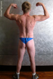 blond muscle hunk flexing tight back muscles speedos pics.jpg