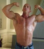 huge massive powerlifter strongman flexing bathroom mirror.jpg