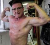 sweaty muscledaddy wearing glasses flexing bigarms.jpg