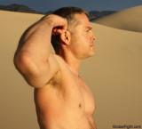 man flexing arms desert bear hiking gay resort pics.jpg