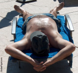 man sunbathing hot sweating daddybear poolside.jpg
