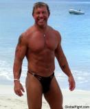 muscleman posing ocean beach photos pictures hot men.jpg