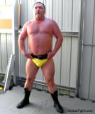 barrelchested hairy beefy man wrestling pose profiles.jpg