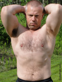 dads flexing big hairy arms stomach pecs crewcut.jpeg