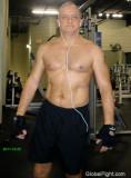 big burly heman tuff heeman posing flexing sweaty gym.jpg