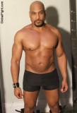 big hunky gay bodybuilder huge thick biceps muscles.jpg