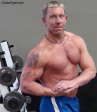 blond muscleman flexing arms tattoos pictures gym.jpg