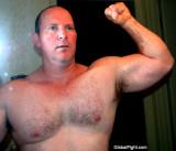 handsome all american jock hot daddie flexing arms.jpg