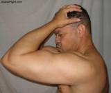 handsome hot black man flexing big arms biceps pics.jpg