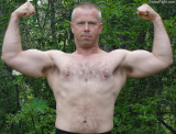 marine daddy shirtless flexing biceps arms big muscles.jpeg