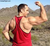 muscleman muscular jock flexing tanktop desert hiking gay dude.jpg