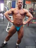 muscleman wearing speedos jockstrap flexing big arms.jpg