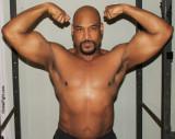 powerfull black bodybuilder powerlifter flexing biceps.jpg