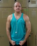 sweaty musclejock posing flexed arms in locker room gym.jpg
