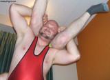 bearded burly gay bear daddy wrestler lifting helpless boy.jpg