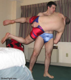 boy carrying daddy fireman lifting hotel room wrestling match.jpg