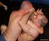 dads putting on painfull necklock uncle wrestling livingroom.jpg