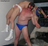 pro wrestling man carrying helpless wrestler knockedout.jpg