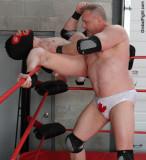 tough daddy wrestler workingover helpless boy opponent.jpg