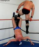wrestler ball stomping mans face hitting kicking stepping on guy.jpg