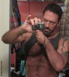 hot hunky professional gay porn wrestler removing tantop.jpg