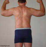 muscular hairy back muscles dads flexing showing off.jpg