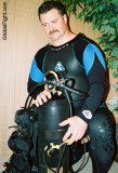wet scuba diver checking diving gear pictures.jpg