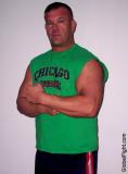 collegiate professional wrestler flexing bigarms.jpg
