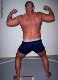 hairy back daddie standing collegiate wrestling mats.jpg