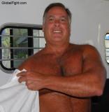 hairy daddy putting on shirt dressing lakehouse.jpg