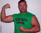 muscledads showing his big guns flexing.jpg