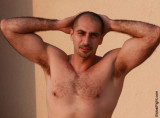 young studly musclepup hottie showing armpits.jpg