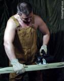 man working wearing coveralls overalls hunky men.jpg