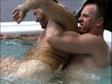 gay mens vacation swimming pool wrestling.jpg