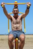 hairy daddy beach workout weight lifting older men.jpg