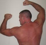 muscledjock flexing big hairy arms forearms older dad.jpg