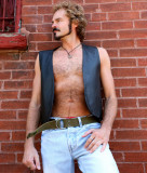 rugged hippie leather daddie hairychest sideburns beard.jpg