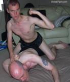 arm twisted behind back winner flexing victorious.jpg