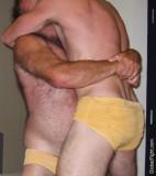 big  hairy daddybear bearhugging son into submission.jpg