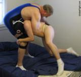 big  husky men wrestling mattress fighting.jpg
