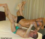 airplane wrestling hold stradling man suspended gay suspension.jpg