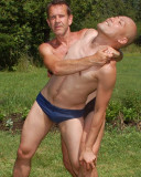 horny wrestlers fighting backyard woods undressed guys.jpg
