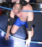 hunky wrestling being choked top rope pics.jpg