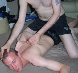wrestler grabbing boys hair arm behind back.jpg