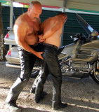 leather bear dominating his slave boy pictures.jpg