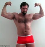 hot bearded muscle stud flexing hugearms.jpg