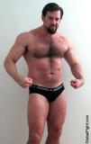 hugearms tight pecs muscular daddy flexing.jpg