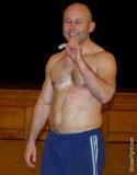 hairy sports cub jock gym shorts mouthguard removing.jpg