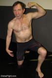 wrestling veterans flexing on mats tournament meet.jpg