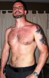 tattooed hairy muscled hunky pup ex wrestler.jpg